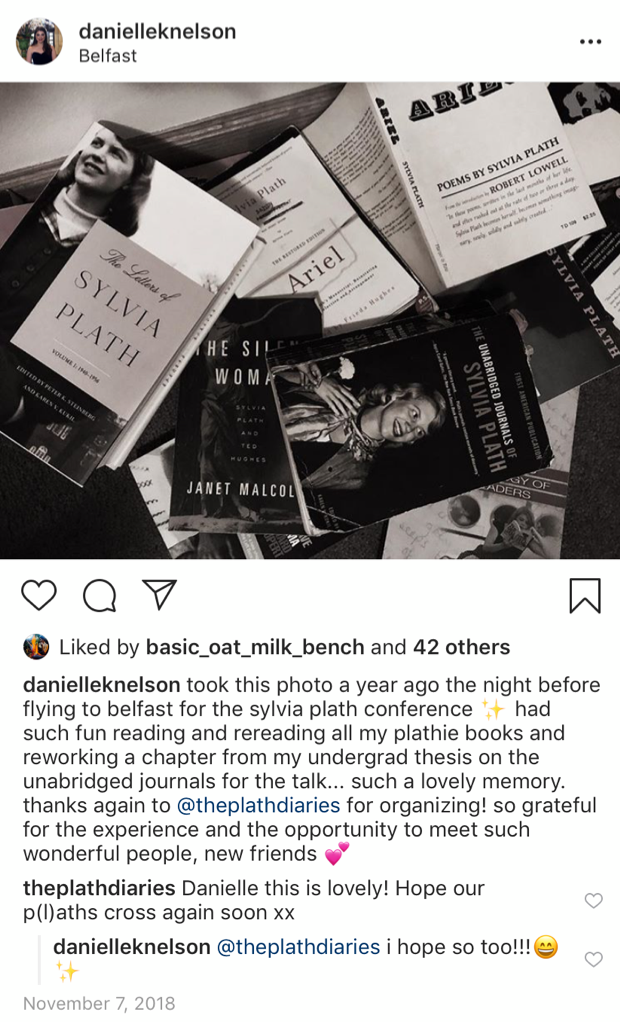 "This Instagram post depicts a pile of Sylvia Plath books. The caption reads, ""took this photo a year ago the night before flying to belfast for the sylvia plath conference ✨ had such fun reading and rereading all my plathie books and reworking a chapter from my undergrad thesis on the unabridged journals for the talk... such a lovely memory. thanks again to @theplathdiaries for organizing! so grateful for the experience and the opportunity to meet such wonderful people, new friends 💕"""